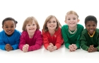 A group of diverse children on a white background